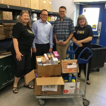 Burlington, ON Food Bank, left to right: Cathy Hart, Andrew Irwin, Robin Bailey Executive Director of the Burlington Food Bank, Ginny Arnott-Wood