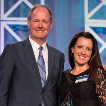 2018 Woman of Distinction April Dorey & Paul Allison, Chairman and CEO