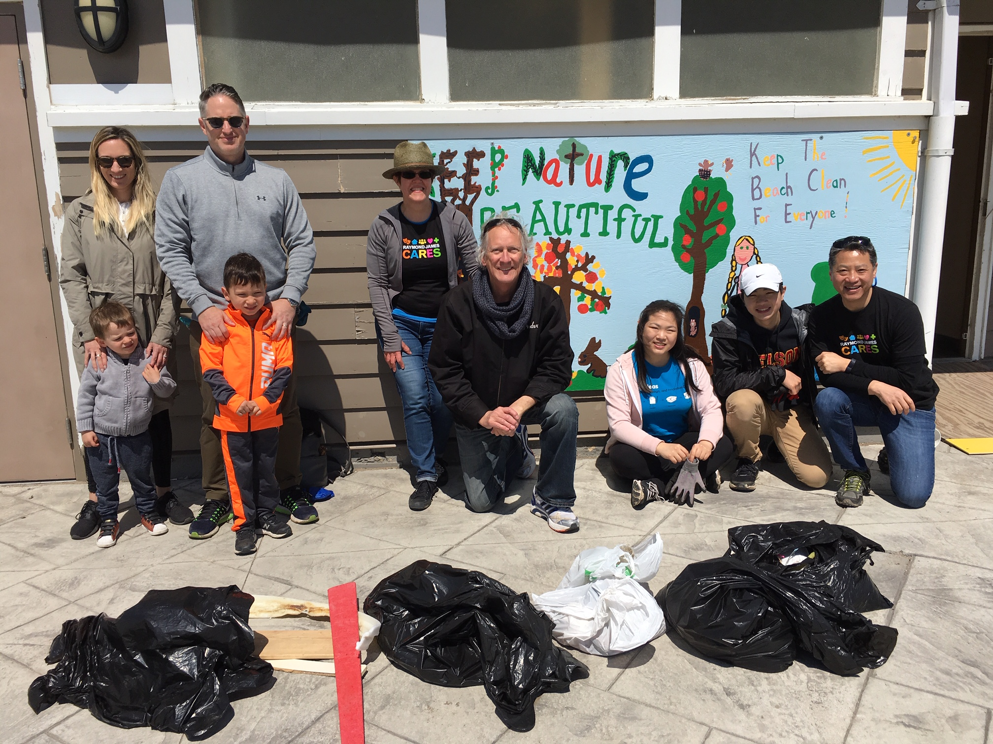 2019 RJ Cares Toronto - Great Canadian Shoreline Cleanup Woodbine Beach: Ryan Lewenza and family; Moira Rosser-Peterson and spouse; Wilson Chen and family
